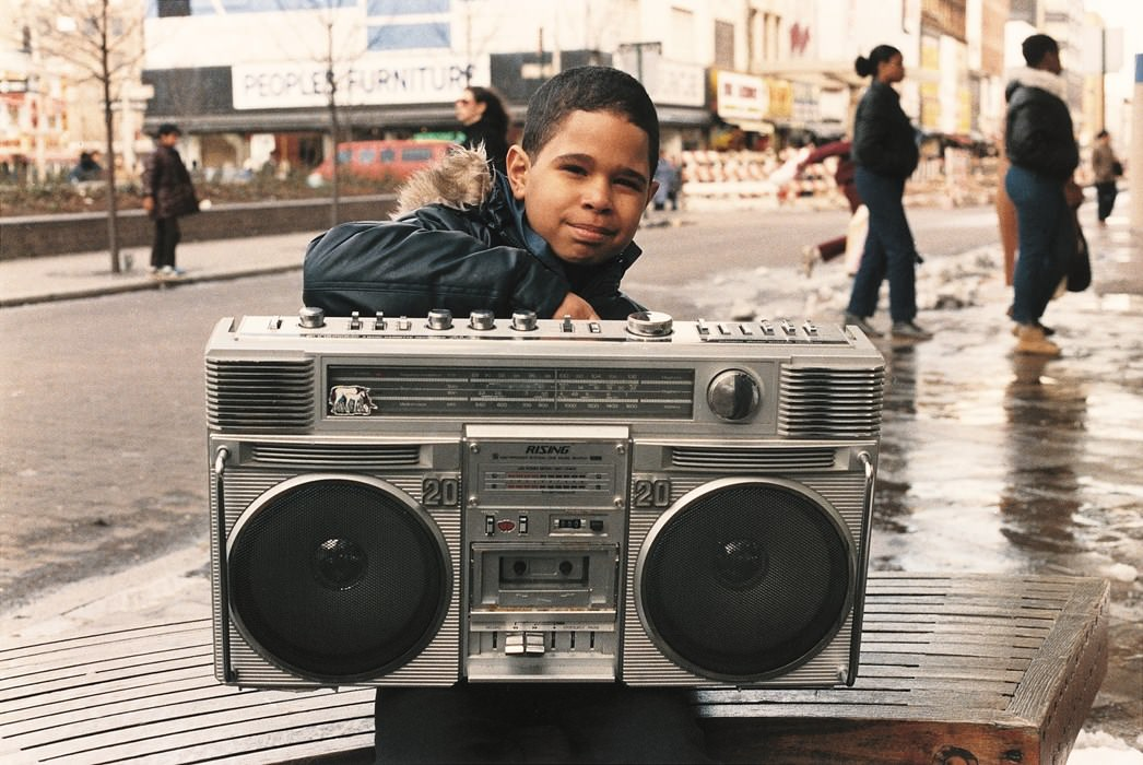 Jamel Shabazz's back in the day old street photographs, boy with boombox.
